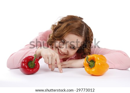 Beautiful young woman with fresh vegetables. Woman wants to eat sweet peppers. Housewife with sweet peppers. Isolated over white background. - stock photo