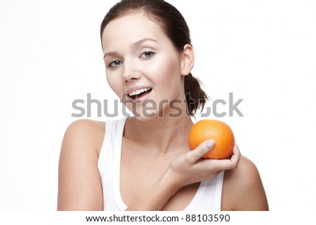 Beautiful young woman with fruit over white background
