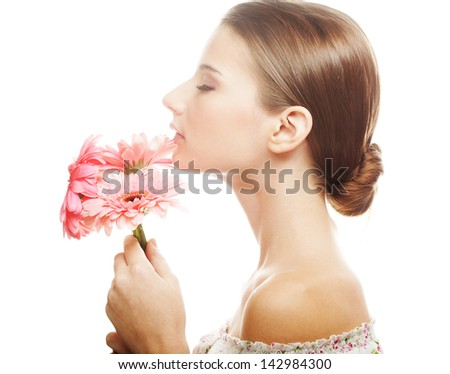 Beautiful young woman with gerber flowers - stock photo