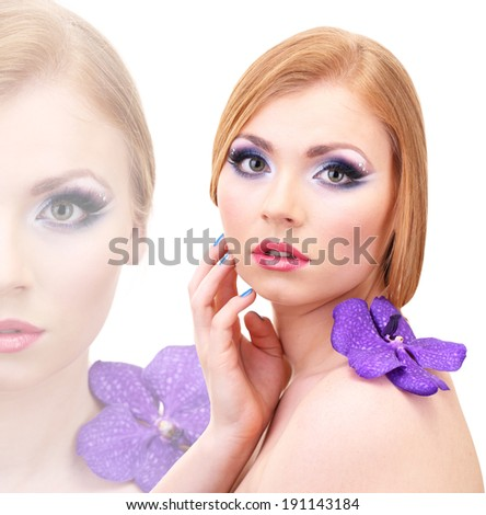 Beautiful young woman with glamour make up and flower isolated on white - stock photo