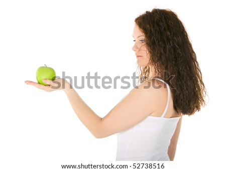 Beautiful young woman with green apple - stock photo