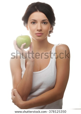 beautiful young woman with green apple, isolated on white - stock photo
