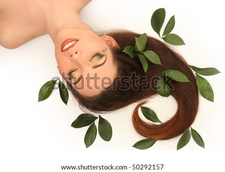 beautiful young woman with green leaves - stock photo