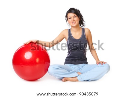 Beautiful young woman with gym ball exercising, isolated on white background - stock photo
