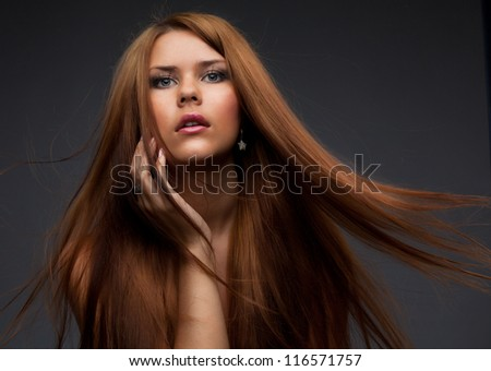 Beautiful young woman with hair flying