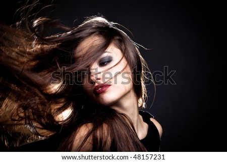beautiful young woman with hair in motion portrait - stock photo