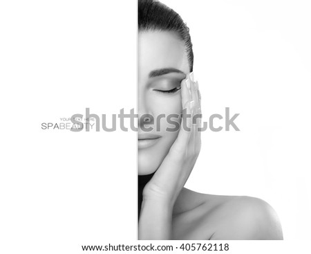 Beautiful young woman with hands on face and closed eyes with a serene expression suitable for skincare and spa concepts. Perfect skin. Black and white portrait isolated with copy space alongside - stock photo