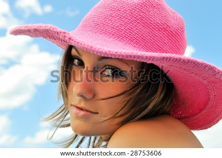 beautiful young woman with hat and the blue sky