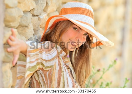 beautiful young woman with hat outdoor in summer - stock photo