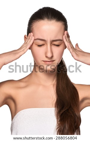 Beautiful young woman with headache touching her temples isolated on  white background - stock photo