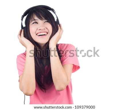 Beautiful young woman with headphone listen to the music isolated on white background - stock photo
