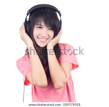 Beautiful young woman with headphone listen to the music isolated on white background