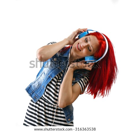 Beautiful young woman with headphones isolated on white - stock photo