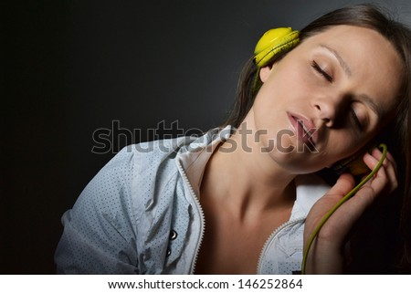 beautiful young woman with headphones listening music