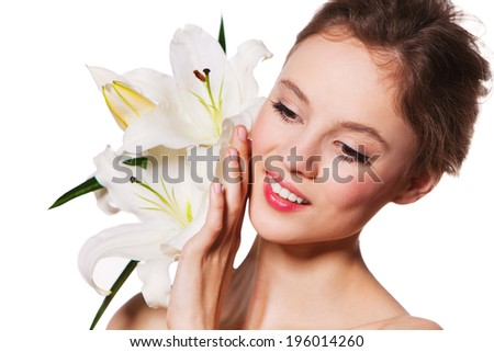beautiful young woman with health skin and lily - stock photo