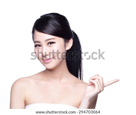 Beautiful young woman with healthy clean skin show something on her hand. Isolated on white. asian beauty - stock photo