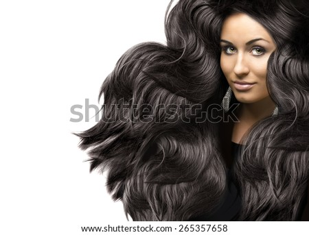 beautiful young woman with healthy curly long shiny hair - stock photo