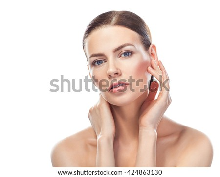 beautiful young woman with healthy face touching clean skin isolated on white background  - stock photo