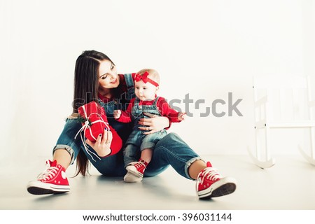 beautiful young woman with her baby having fun - stock photo