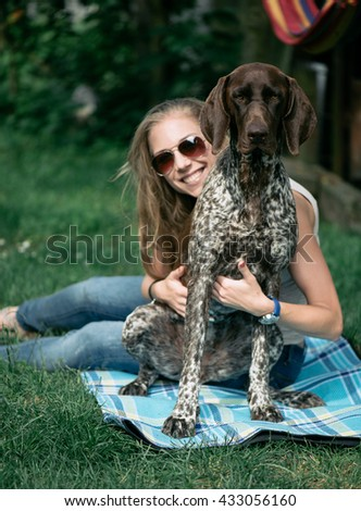 beautiful young woman with her dog outdoor - stock photo