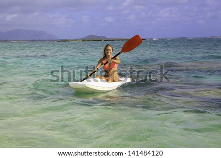beautiful young woman with her surf ski