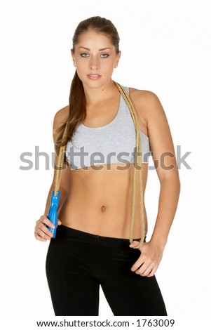 Beautiful Young Woman with Jump Rope Around Neck - stock photo