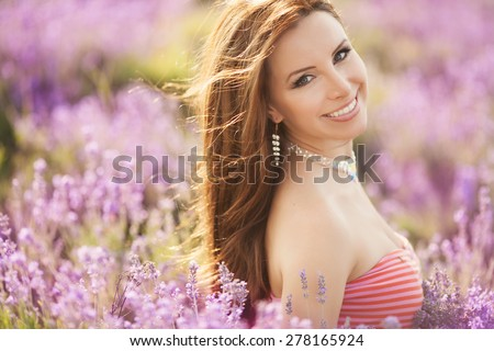 Beautiful young woman with lavender flowers, happy girl in lavender field, spa and aromatherapy, lavender background, series. sunset soft focus - stock photo