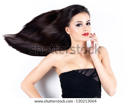 Beautiful young woman with long brown straight hairs - stock photo