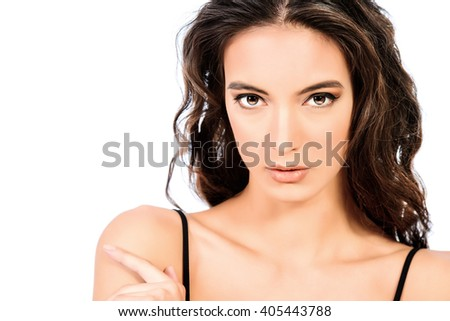 Beautiful young woman with long brunette hair over white background. Fashion style photo. - stock photo