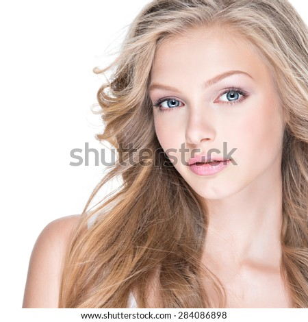 Beautiful young woman with long curly hair over white background. - stock photo