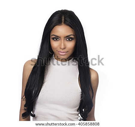 Beautiful young woman with long dark glossy hair and flawless skin exotic facial features  - stock photo