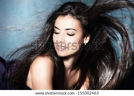 beautiful young woman with long fluttering dark hair
