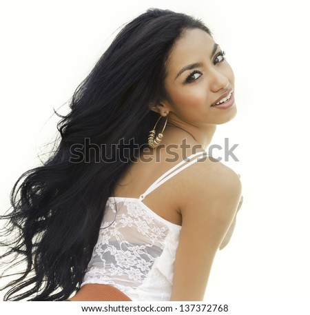 Beautiful young woman with long hair. - stock photo