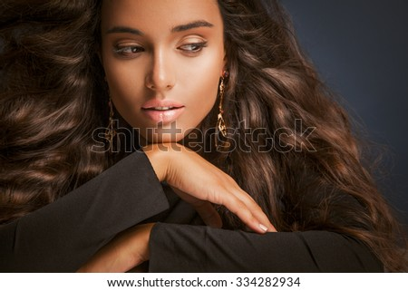 Beautiful young woman with long hair and makeup. Studio shot, Horizontal - stock photo