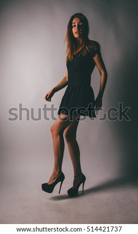 Beautiful young woman with long hair . high-heeled shoes