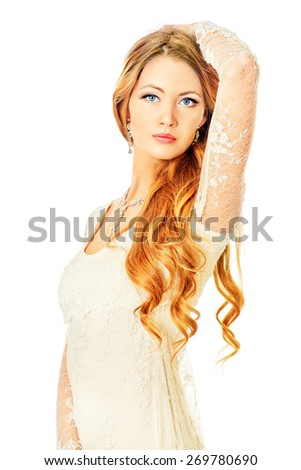 Beautiful young woman with long hair. Make-up, cosmetics. Jewelry. Haircare. Isolated over white.  - stock photo