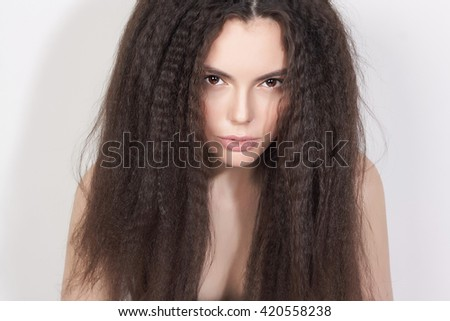 Beautiful young woman with long healthy hair.Fashion portrait of hairy Girl - stock photo