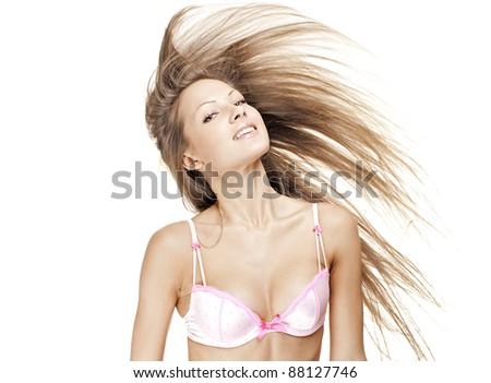 beautiful young woman with long natural hair - stock photo