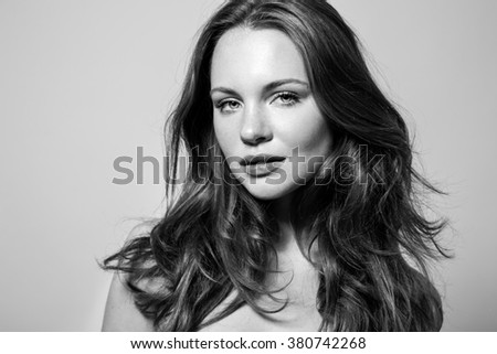 Beautiful Young Woman with Long shiny hair. The Black-and-white photo