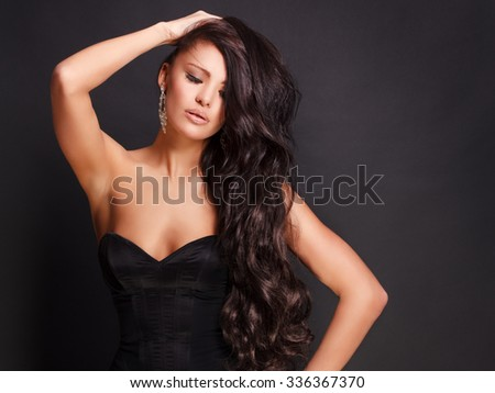 Beautiful young woman with luxurious hair - stock photo