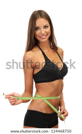 beautiful young woman with measuring tape, isolated on white - stock photo
