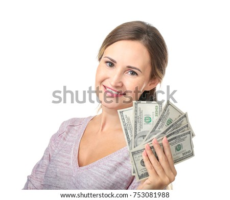 Beautiful young woman with money on white background