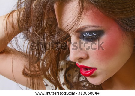 Beautiful Young Woman with Moody Eyes and Long Eyes - stock photo