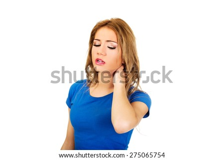 Beautiful young woman with neck pain. - stock photo