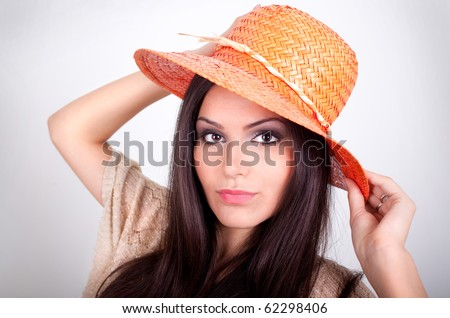 Beautiful young woman with orange hat