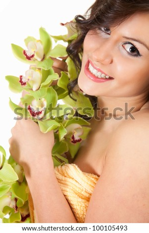 beautiful young woman with orchid flowers, white background