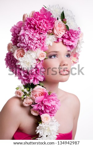 Beautiful young woman with peony flower