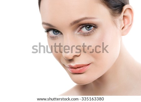 Beautiful young woman with perfect natural makeup look 