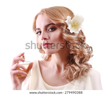 Beautiful young woman with perfume bottle isolate on white - stock photo
