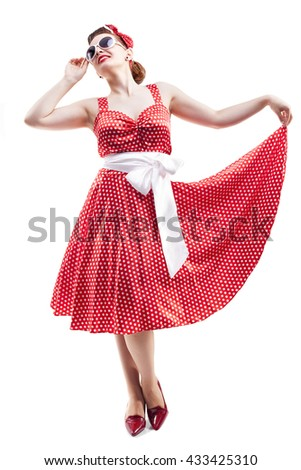 Beautiful young woman with pin-up make-up and hairstyle posing on white background - stock photo